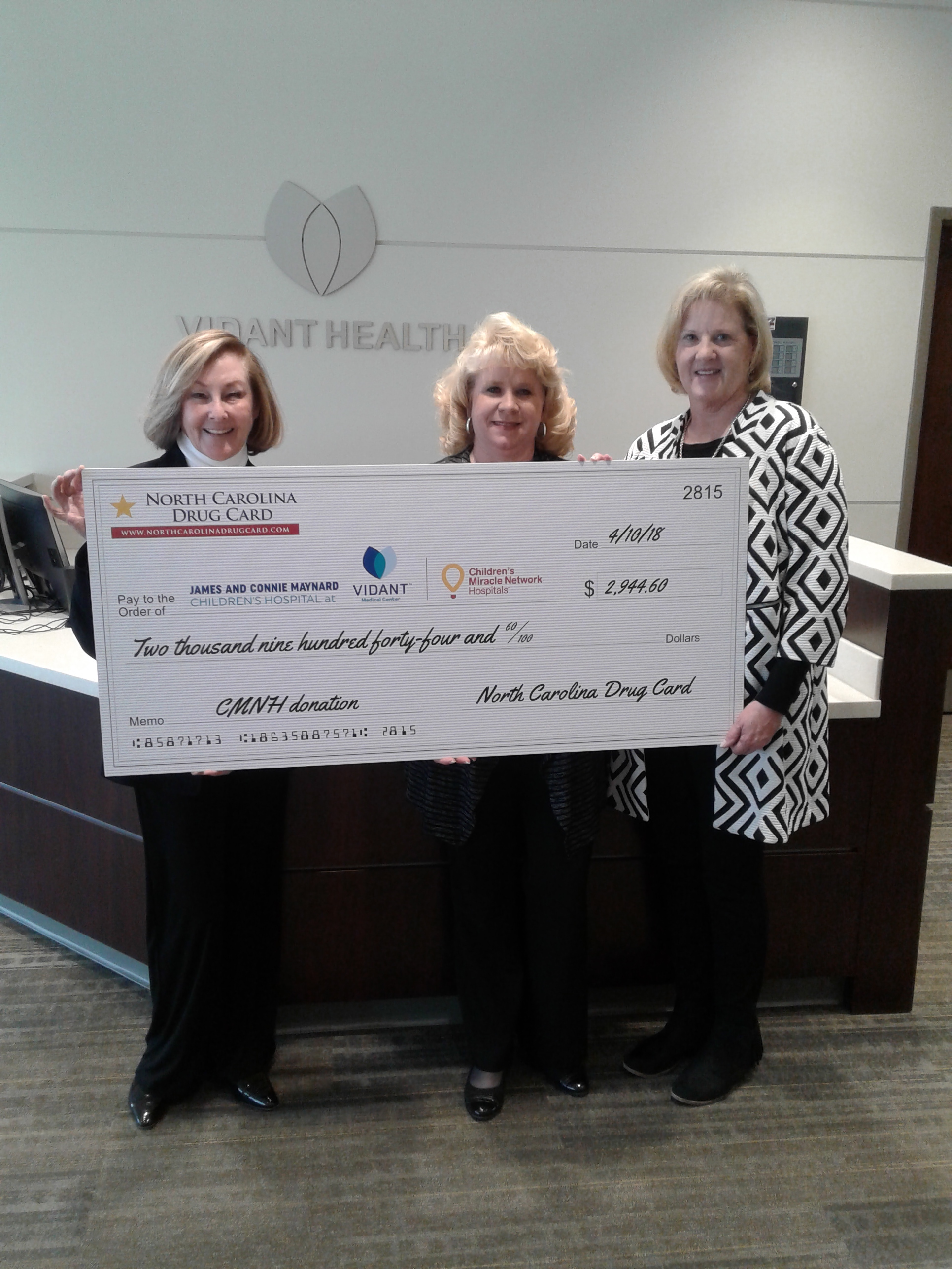 North Carolina Drug Card, powered by United Networks of America, Presents Donation to James and Connie Maynard Children's Hospital