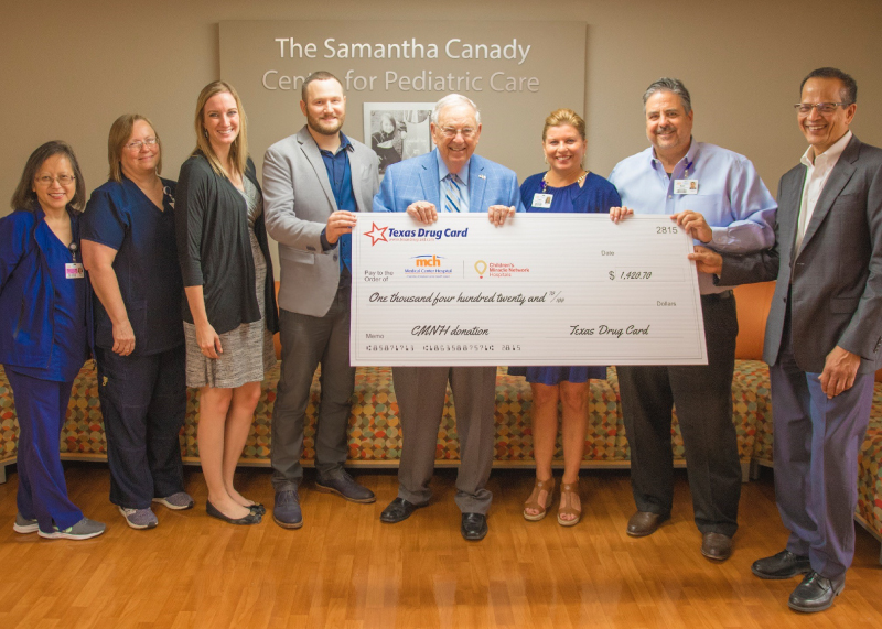 Texas Drug Card Presents Donation to Medical Center Health